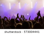 crowd people with hands in the... | Shutterstock . vector #573004441