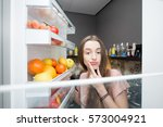woman taking food from the... | Shutterstock . vector #573004921