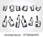 whiskey bottle and glass set.... | Shutterstock .eps vector #573006454