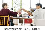 fist bump corporate colleagues... | Shutterstock . vector #573013801