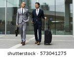 business men walk talk luggage | Shutterstock . vector #573041275