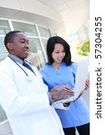 an ethnic medical man and woman ... | Shutterstock . vector #57304255