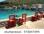 red chairs and tables of a... | Shutterstock . vector #573047395