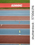 Empty red and blue striped athletic track - stock photo