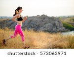 young woman running on the... | Shutterstock . vector #573062971