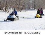 Small photo of Pavlodar, Kazakhstan - January 15, 2017: Passengers on a towable tube on the frozen river front view