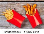 two boxes with french fries....   Shutterstock . vector #573071545