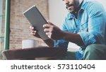 pensive african man using... | Shutterstock . vector #573110404