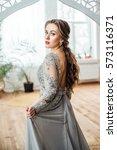 young beautiful woman in grey...   Shutterstock . vector #573116371