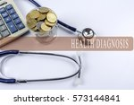 a stethoscope with piles of... | Shutterstock . vector #573144841