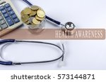 a stethoscope with piles of... | Shutterstock . vector #573144871