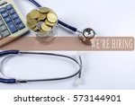 a stethoscope with piles of... | Shutterstock . vector #573144901