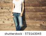 woman posing in blue jeans and... | Shutterstock . vector #573163045
