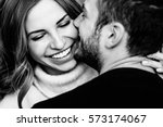 Stock photo young couple in love hug each other on the black background 573174067