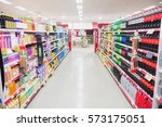 Small photo of Facing view of an aisle in supermarket
