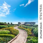 Path  In Fresh Garden With Blu...