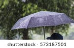 a person with an umbrella in... | Shutterstock . vector #573187501