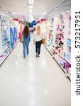 women walking in a shop | Shutterstock . vector #573217951