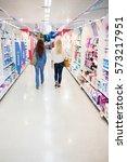 women walking in a shop | Shutterstock . vector #573217951