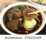 braised beef noodle soup with... | Shutterstock . vector #573225169