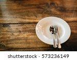 white plate on wooden table.   Shutterstock . vector #573236149
