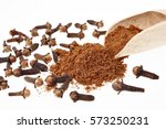 cloves whole and clove powder   Shutterstock . vector #573250231