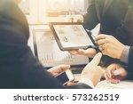 business adviser analyzing... | Shutterstock . vector #573262519