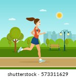 running in city park. woman... | Shutterstock .eps vector #573311629