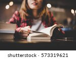 hipster woman teenager sitting... | Shutterstock . vector #573319621