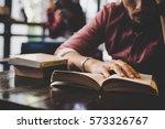 hipster bearded man reading... | Shutterstock . vector #573326767