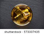 round glass of whiskey with ice ... | Shutterstock . vector #573337435