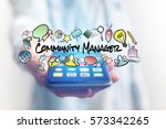 Small photo of Concept of man holding smartphone with community manager title and multimedia icons flying around