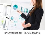 businesswoman pointing to the... | Shutterstock . vector #573350341