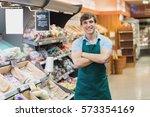 portrait of man grocer smiling... | Shutterstock . vector #573354169