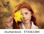 red haired little girl is... | Shutterstock . vector #573361384