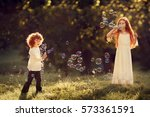 red haired little brother and... | Shutterstock . vector #573361591