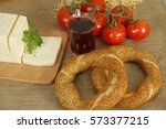 pretzel and tomato | Shutterstock . vector #573377215