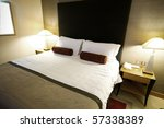 Stock photo double bed in the hotel room 57338389
