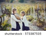 little girl with grapes... | Shutterstock . vector #573387535