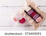 colorful tasty macaroons in... | Shutterstock . vector #573405091