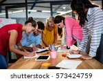 casual business team writing in ... | Shutterstock . vector #573424759