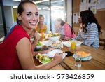 casual business team eating... | Shutterstock . vector #573426859