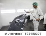 worker man spray painting on... | Shutterstock . vector #573450379