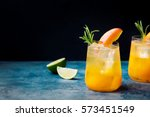 peach cocktail  fizz with... | Shutterstock . vector #573451549