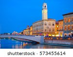 pisa by night  with a view of... | Shutterstock . vector #573455614