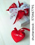 valentine red heart with a gift | Shutterstock . vector #573467791