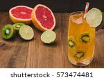 Small photo of cocktail and abundance of fruit/cocktail and abundance of fruit on a wooden background