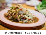papaya salad and raw shrimp... | Shutterstock . vector #573478111
