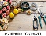florist at work  woman making...   Shutterstock . vector #573486055