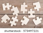 wooden puzzle pieces on a... | Shutterstock . vector #573497221